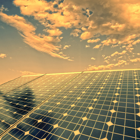 electric energy: photovoltaic cells and sunlight background