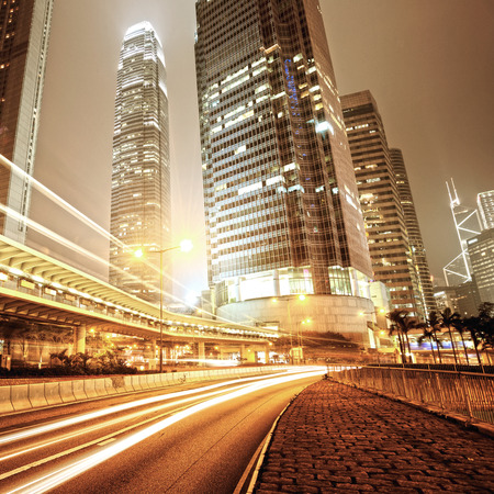 traffic building: Fast moving cars at night