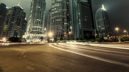 urban road: the light trails on the modern building background in shanghai china