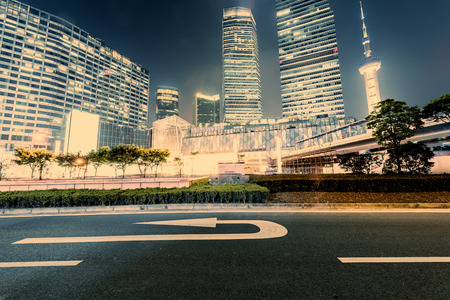 city scene: the light trails on the modern building background in shanghai china