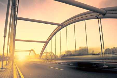 infrastructure buildings: road through the bridge with blue sky background of a city Stock Photo