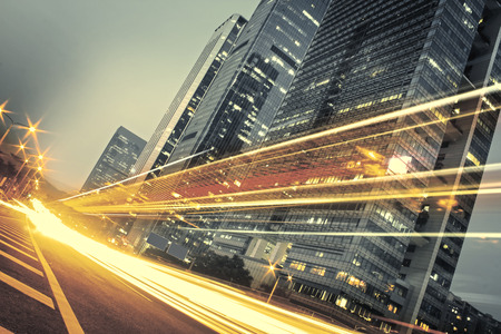 of movement: the light trails on the modern building background in city Stock Photo