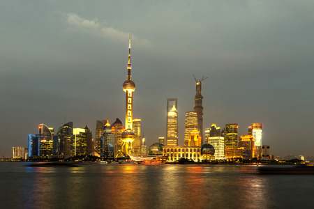 huangpu: panoramic view of shanghai skyline with huangpu river at dusk