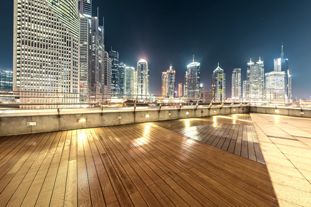 context: The roof platform and the modern urban context at night
