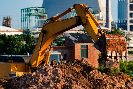 assignments: Excavators are assignments and refinery background