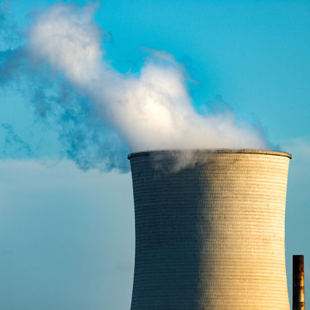 smokestacks: The smokestacks of coal-fired power plants in the blue sky background