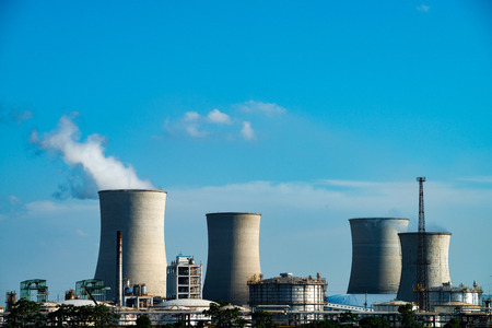 thermal pollution: The smokestacks of coal-fired power plants in the blue sky background