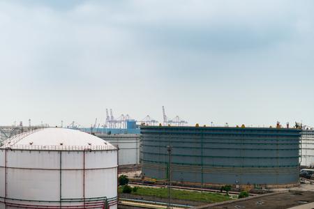 fuel storage: White fuel storage tank against blue sky Stock Photo