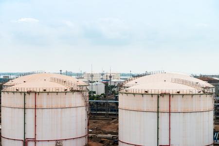 fuel storage: White fuel storage tank against blue sky Editorial
