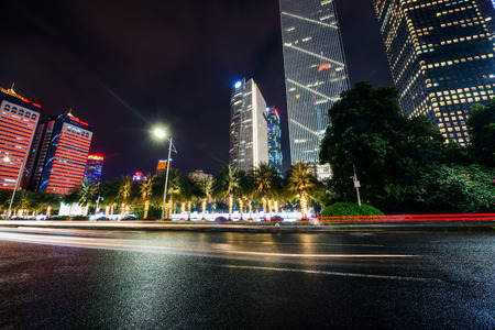 accelerated: the light trails on the modern building background Stock Photo