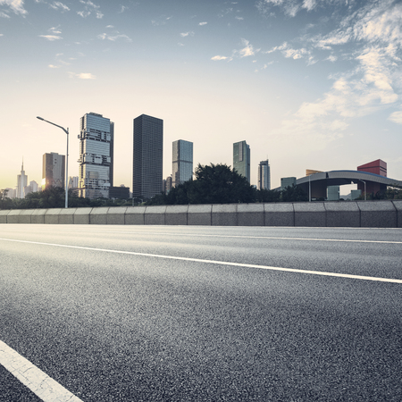 carriageway: empty asphalt road of a modern city with skyscrapers Stock Photo