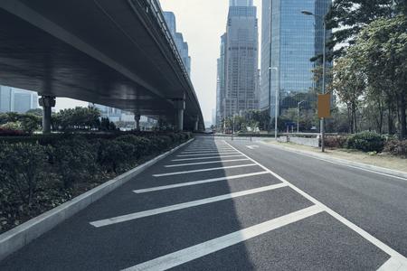 empty asphalt road of a modern city with skyscrapers Reklamní fotografie
