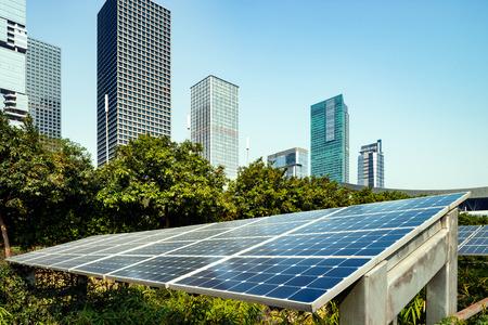 Solar panels and urban construction background Standard-Bild