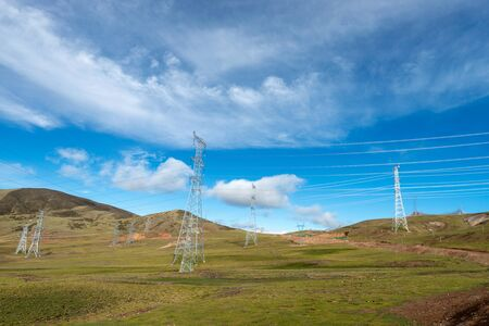Relay station and power transmission lines Stockfoto