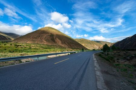 highway and snow mountain in tibet plateau 스톡 콘텐츠