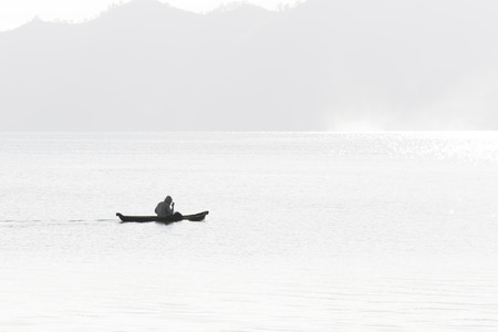 solely: Fishermen in the foggy morning Stock Photo