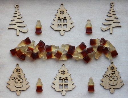 Christmas decorations in the form of wooden Christmas trees and marmalades in the form of bottles Stok Fotoğraf