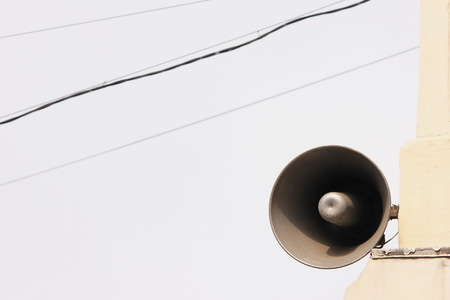 Loudspeaker on the old building. Information and communication