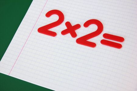 A simple mathematical example in a clean school notebook. Back to school. The concept of primary education.