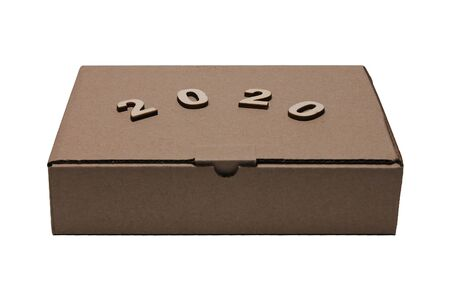 2020 numerals of the new year on the Cardboard brown closed rectangular box isolated on white background close-up.