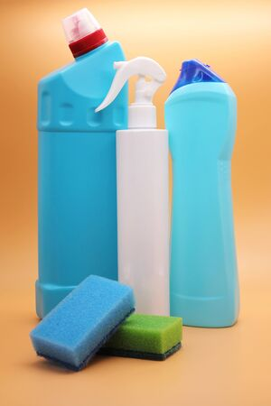 Bottles with household chemicals and foam sponge. Detergents and cleaning products. Cleaning products