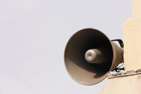 Loudspeaker on the old building. Information and communication. Copy space.