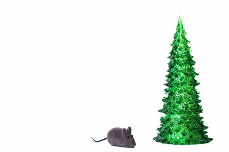 Green toy Christmas tree and toy grey mouse isolated on white background. Symbol of The new year 2020. Copy space.