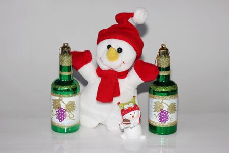 Toy snowman and Christmas toys in the form of wine bottles. The concept of New year and Christmas. Happy New year.