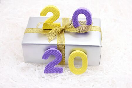 Christmas background 2020 with colored numbers on the gift box. The concept of Christmas and the New year. Stok Fotoğraf - 131434507