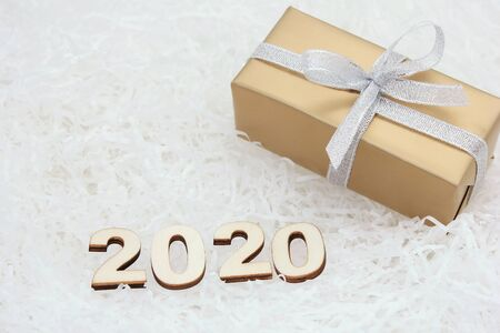 2020 New year background. Wooden numbers and gift box. Happy new year.