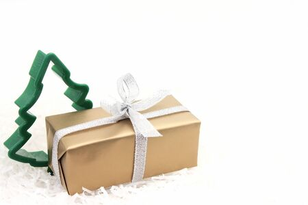 A box with a gift and a figure of a Christmas tree are isolated on white background. Happy new year. The concept of Christmas and the New year. Stok Fotoğraf