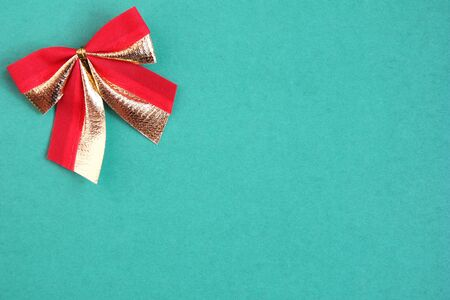 red bow on a green background. Empty space for text. Happy New Year. New year and Christmas concept.