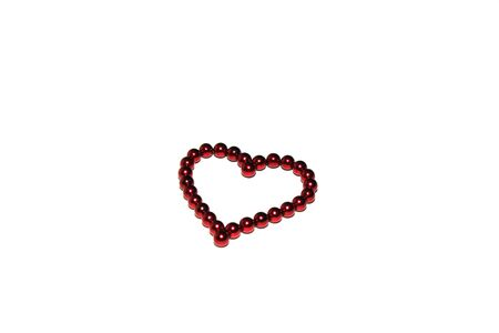Red heart made of red magnetic beads is isolated on white background. Concept of love and Valentines day. Greeting card. Copy space.