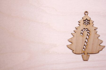Wooden Christmas tree figurine on a wooden background. Copy space. New year and Christmas concept. Stok Fotoğraf - 132360763