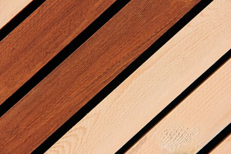 Wooden boards dark and light are arranged in a row diagonally. Wooden background. Stok Fotoğraf - 132274041