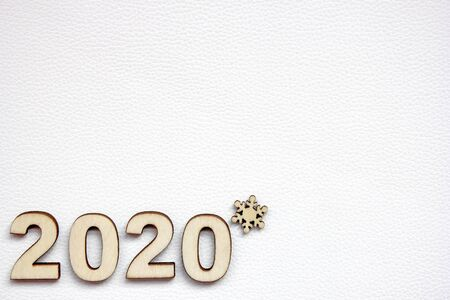 The 2020 new year's number is lined with wooden numerals on a white leather surface. Copy space. Stok Fotoğraf - 132351664