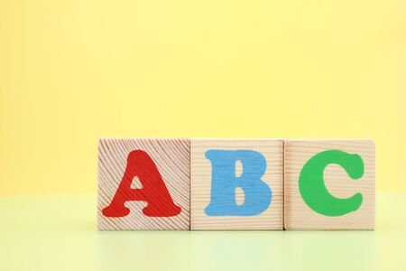 ABC -the first letters of the English alphabet on wooden cubes. Learn foreign languages. English for beginners. Copy space. Stok Fotoğraf - 133454000