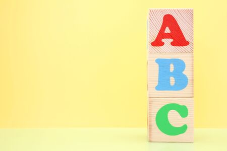 ABC -the first letters of the English alphabet on wooden toy cubes. Learn foreign languages. English for beginners. Copy space.