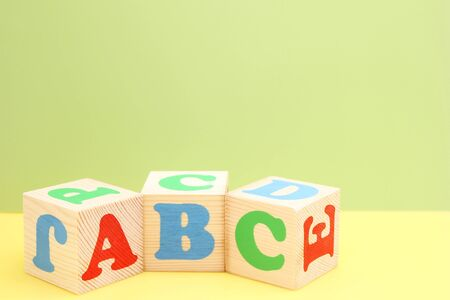 ABC -the first letters of the English alphabet on wooden toy cubes. Learn foreign languages. English for beginners. Copy space. Stok Fotoğraf - 132782112