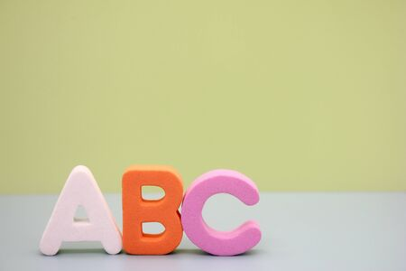ABC first letters of the English alphabet on a green background. Empty space for text. Learning foreign language. English for beginners. Copy space. Stok Fotoğraf