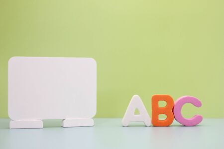 ABC - the first letters of the English alphabet near the white Board. Concept of education. Copy space. Stok Fotoğraf - 133454551