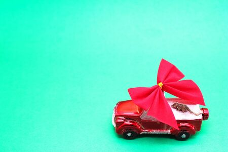 Small metal mouse on a red toy car . New year 2020 is approaching. The mouse is a symbol of The new year 2020 according to the Chinese calendar.