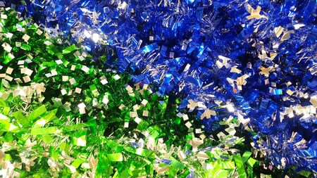 Christmas tinsel green and blue. Christmas background. Happy new year.