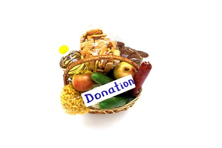 Basket with food isolated on a white background. Food delivery. A donation of food.