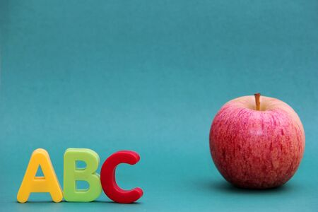 English ABC alphabet letters next to apple. Learning foreign language. English for beginners. 版權商用圖片