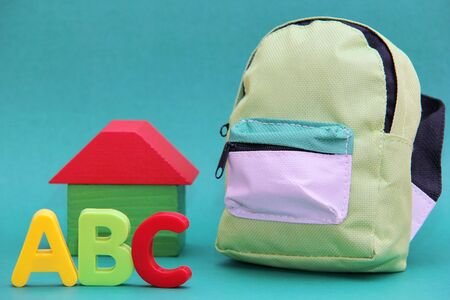 ABC - letters of the English alphabet to the will of a wooden house and a school bag. Back to school.