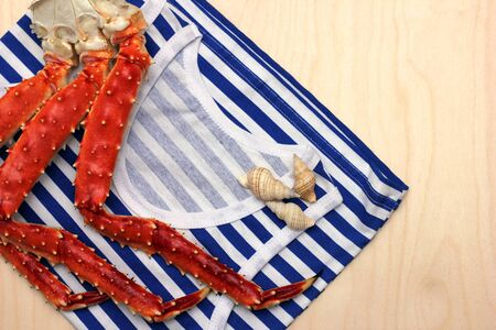 The prepared legs of the Kamchatka king crab lie on a striped vest.