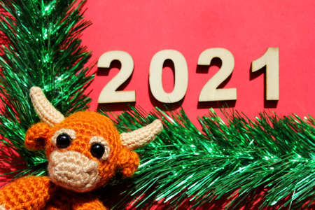 The bull is the symbol of the New year 2021. Happy New year. Christmas card with 2021 new years number.