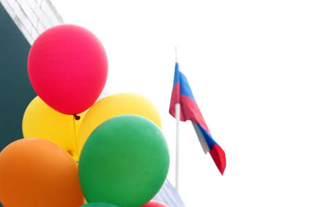 Colored balloons on the background of the school building. Back to school concept.