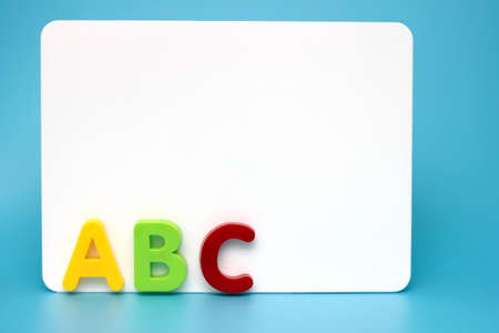 ABC - the first letters of the English alphabet near the white Board. Concept of education. Copy space.